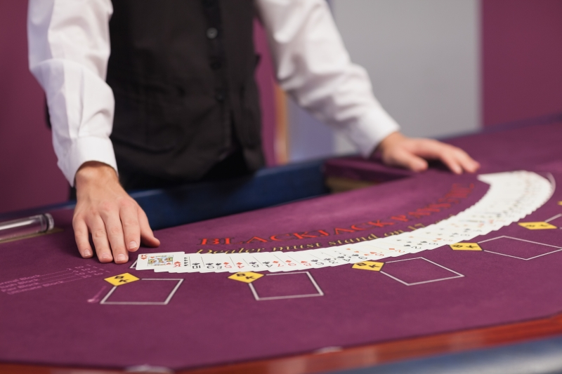 3928729-man-dealing-out-cards-in-a-casino